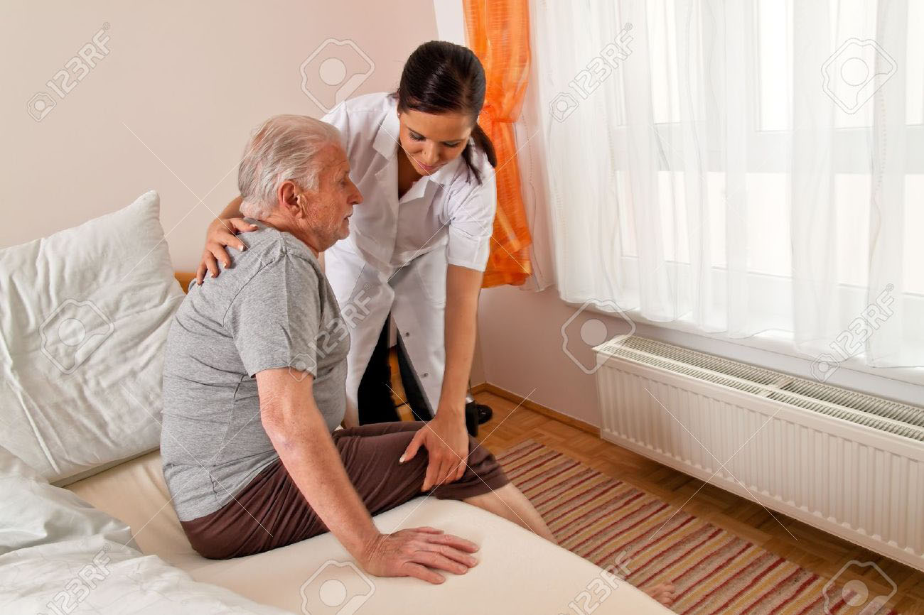 Nurse Helping Old Man To Stand Up - In Home Aged Care - ESP Healthcare