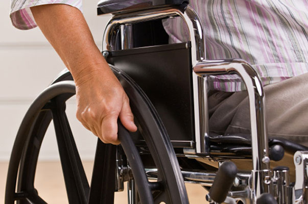 Hand Pushing The Wheelchairs Wheel - Sydney Home Care - ESP Healthcare