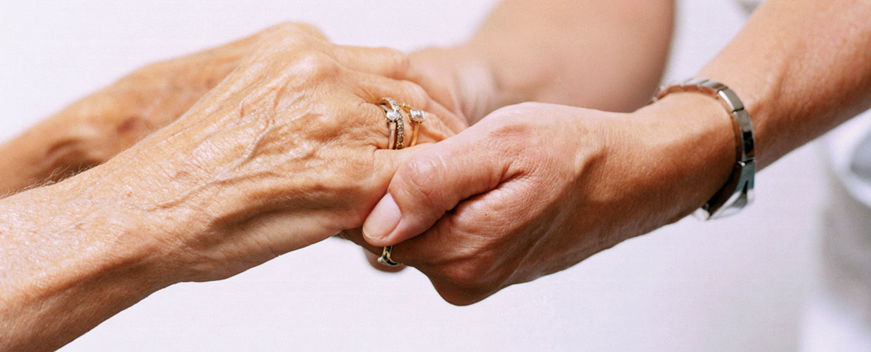 A Caring Nurse Holds A Senior Hands - In Home Help For The Elderly - ESP Healthcare