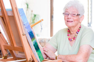 An Elderly Woman Painting - Home Care For Elderly - ESP Healthcare