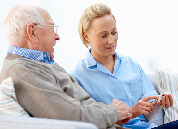 A Female Nurse Explaining To a Senior Man About His Medication - Home Care Sydney - ESP Healthcare
