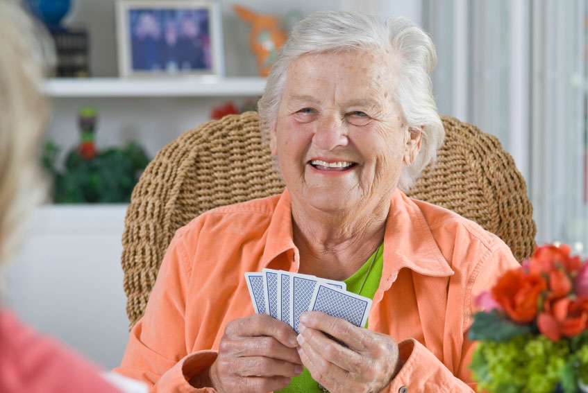 A Senior Lady Playing Cards - Home Care Package Provider - ESP Healthcare
