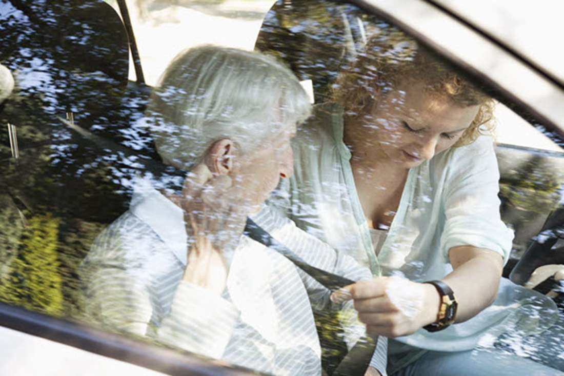 Senior Woman Getting Help with Fastening Her Seat belt In The Car - Sydney Home Care - ESP Healthcare