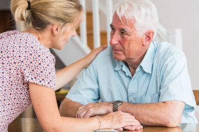 A Nurse Talking To An Elderly Man While Holding His Hand - Home Care Solutions - ESP Healthcare