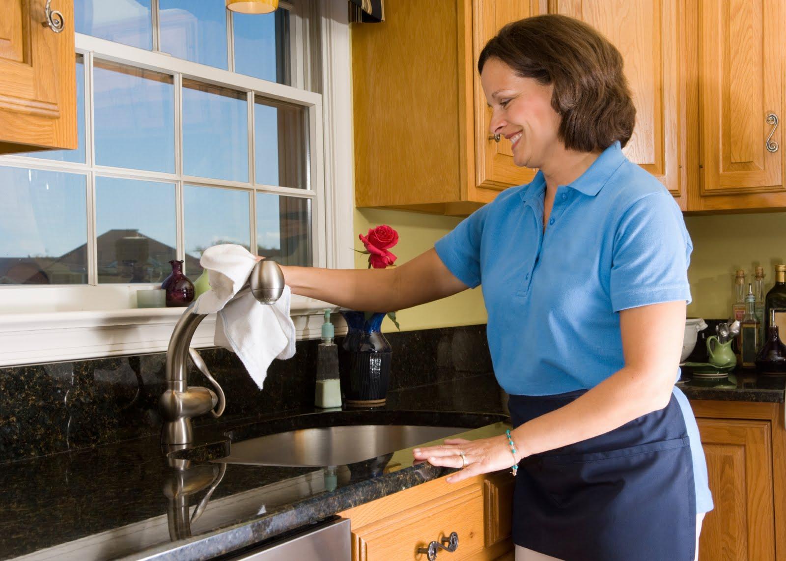 A Woman Wipes The Kitchen Faucet - Domestic Assistance Services - ESP Healthcare