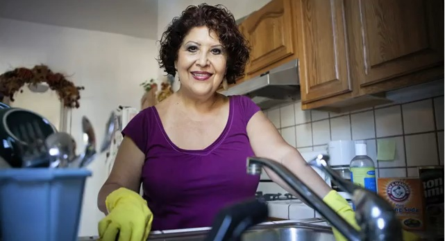 A Woman Cleaning The Kitchen - Domestic Assistance - ESP Healthcare