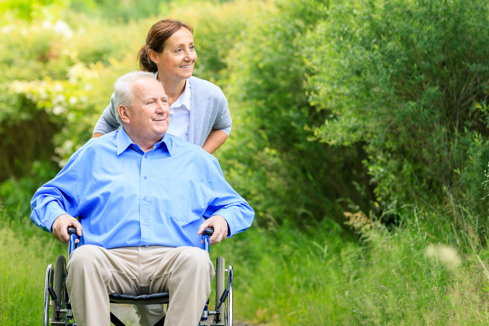 A Female Nurse Pushing An Old Man In Wheelchair - In Home Care Sydney - ESP Healthcare