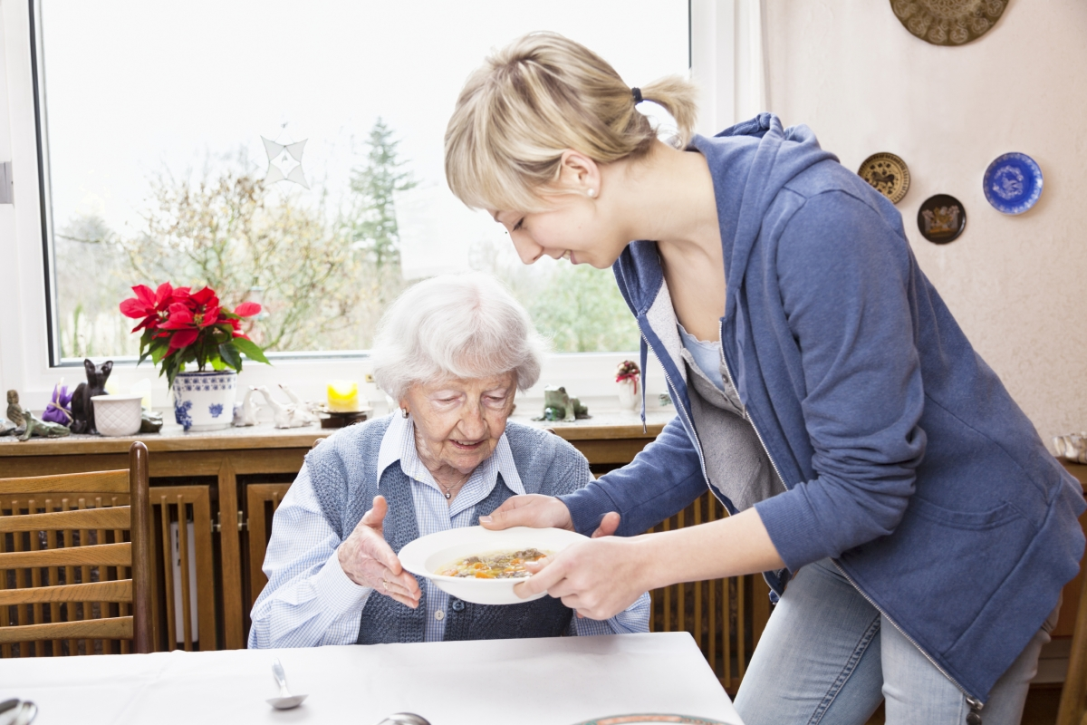 A Young Woman Prepares An Old Woman's Meal -In  Home Care Sydney - ESP Healthcare