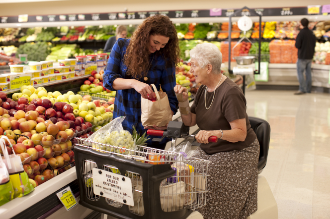 Young Female Helping Senior Woman with The Groceries - Home Care Sydney - ESP Healthcare