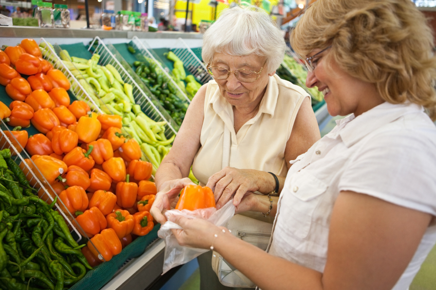 A Woman Helping Elderly Lady With Grocery Shopping - In Home Help For The Elderly - ESP Healthcare