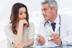 A Male Doctor Explains To A Woman About Her Medication - Care For Disability - ESP Healthcare
